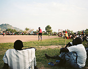 JUBA, SOUTH SUDAN – JUNE 1, 2018: Local teams play soccer on a dirt pitch in South Sudan's rapidly changing capitol city.