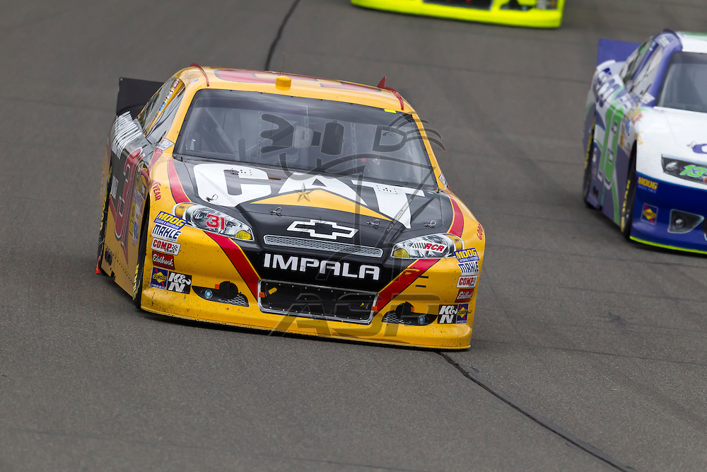 KANSAS CITY, KS - APR 22, 2012:  Jeff Burton (31) races during the STP 400 at the Kansas Speedway in Kansas City, KS.