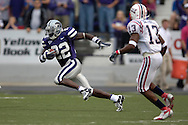 Kansas State's Justin McKinney (L) sprints past Florida Atlantic's Rickey Bethel (R), as McKinney takes the opening Kick-Off for a 88-yard touchdown return at Bill Snyder Family Stadium in Manhattan, Kansas, September 9, 2006.  The Wildcats beat Florida Atlantic 45-0.