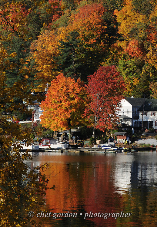 GREENWOOD LAKE, NY.  Fall foliage is reflected on the water at Defeo's Marina in Greenwood Lake, NY on Saturday morning, October 20, 2012.  © Chet Gordon/THE IMAGE WORKS