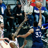 06 December 2017: Minnesota Timberwolves center Karl-Anthony Towns (32) goes for the layup past LA Clippers center DeAndre Jordan (6) during the Minnesota Timberwolves 113-107 victory over the LA Clippers, at the Staples Center, Los Angeles, California, USA.