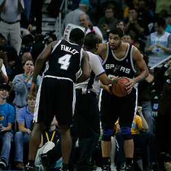 29 March 2009: San Antonio Spurs center Tim Duncan (21) and forward Michael Finley (4) talk with an official during a 90-86 victory by the New Orleans Hornets over Southwestern Division rivals the San Antonio Spurs at the New Orleans Arena in New Orleans, Louisiana.