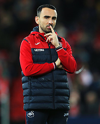 Swansea City caretaker manager Leon Britton watches his players warm up - Mandatory by-line: Matt McNulty/JMP - 26/12/2017 - FOOTBALL - Anfield - Liverpool, England - Liverpool v Swansea City - Premier League