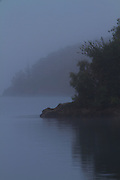 Acacia Bay shrouded in morning mist, Late Taupo, New Zealand