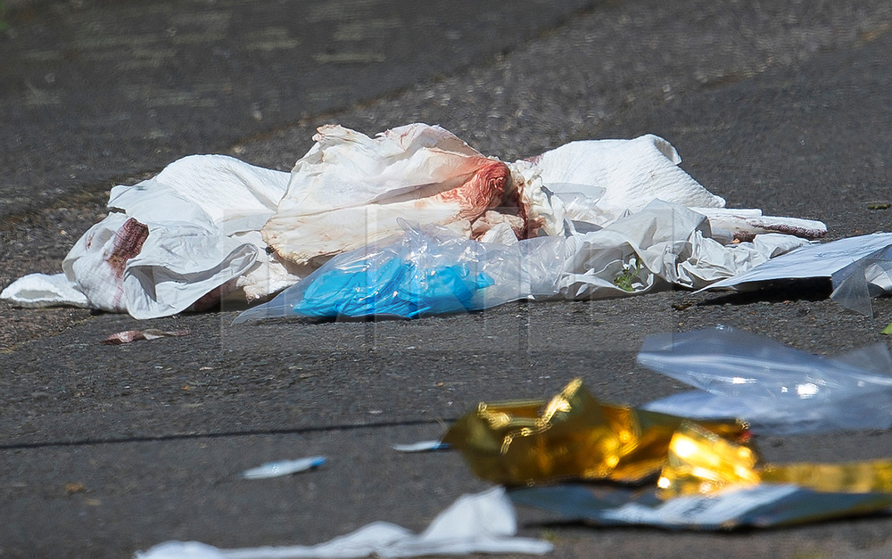 © Licensed to London News Pictures. 11/06/2018. London, UK. Blood stained bandages lie on the ground next to where a 17 year old was critically injured in a stabbing in Harrow last night. Another youth was stabbed in nearby Northolt.Photo credit: Peter Macdiarmid/LNP