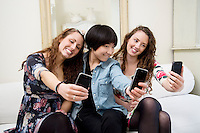 Female friends taking self photograph