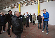 Fergus Storrier of Showcase the Street shows Dee Promotion lottery agents where the office facilities will go at the new Dundee FC academy indoor facility at Dundonald Street<br /> <br />  - &copy; David Young - www.davidyoungphoto.co.uk - email: davidyoungphoto@gmail.com