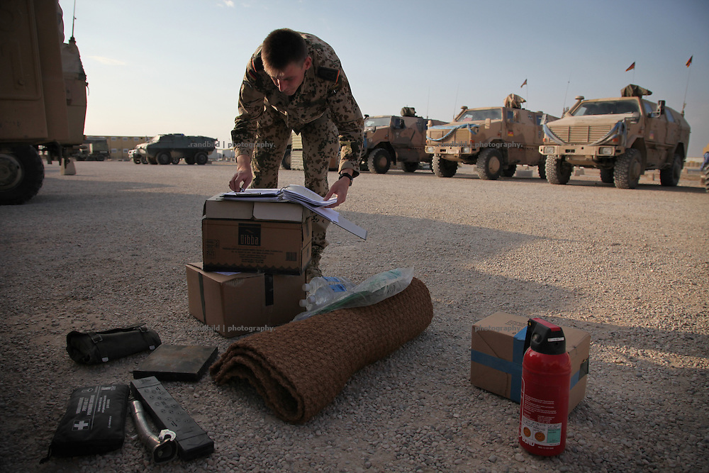 Soldiers from german military police checking their equipment in the Camp Marmal, Mazar-e Sharif