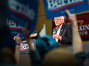 02 MARCH 2020 - ST. PAUL, MINNESOTA: People waving campaign signs partially obscure US Senator BERNIE SANDERS (Ind-VT) at at a Sanders Get Out the Vote rally in the RiverCentre in St. Paul. More than 8,400 people attended the rally. Minnesota is a Super Tuesday state this year and Minnesotans will go to the polls Tuesday. Minnesota Sen. Amy Klobuchar was expected to win her home state, but she dropped out early Monday, March 2.         PHOTO BY JACK KURTZ