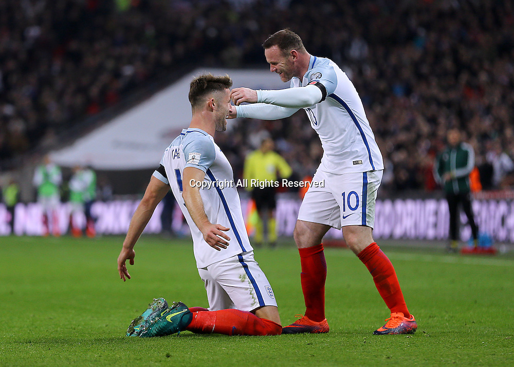 11.11.2016. Wembley Stadium, London, England. World Cup Qualifying Football. England versus Scotland. Gary Cahill of England celebrates with Wayne Rooney of  after heading past Scotland Goalkeeper Gordon Greer and making it 3-0