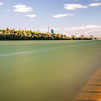 The Guadalquivir river and Barqueta Bridge, Seville, Spain. Long exposure shot.