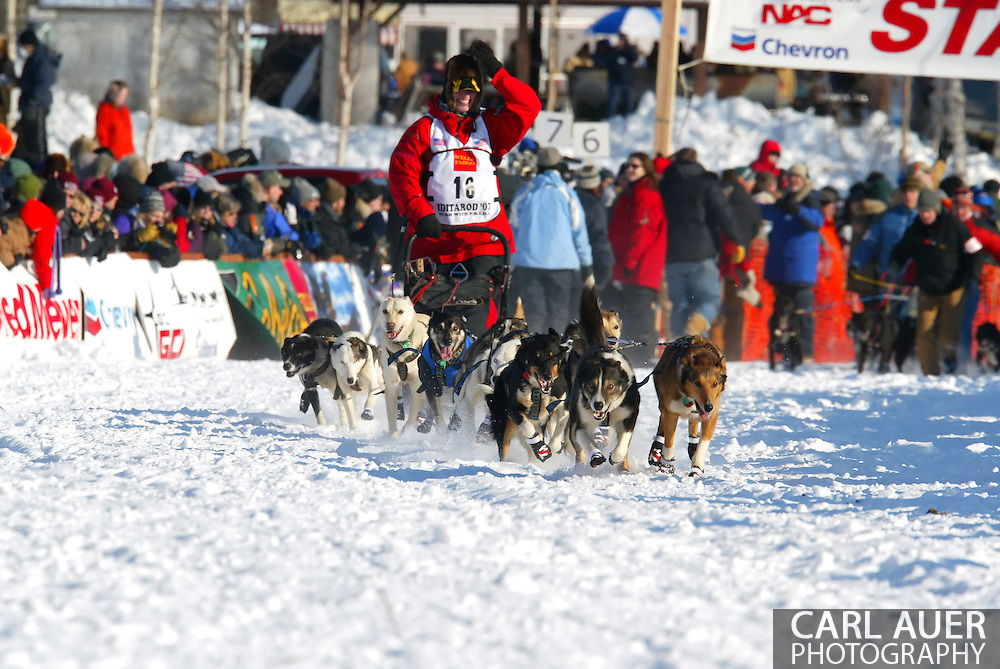 3/4/2007:  Willow, Alaska -  Veteran Aliy Zirkle of Two Rivers, AK heads across Willow Lake for the first competitive leg of the 35th Iditarod Sled Dog Race