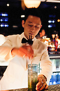 Bar staff mixing drinks at Unico.
