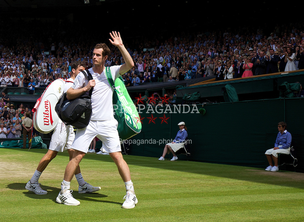 LONDON, ENGLAND - Wednesday, July 2, 2014: Andy Murray (GBR) walks off court dejected after losing to Grigor Dimitrov (BUL) during the Gentlemen's Singles Quarter-Final match on day nine of the Wimbledon Lawn Tennis Championships at the All England Lawn Tennis and Croquet Club. (Pic by David Rawcliffe/Propaganda)