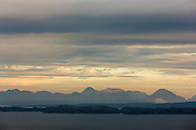 View from Wester Ross coastal trail near Applecross, in North West Coast of Scotland - Isle of Raasay and Skye with Cuillin mountains at sunset