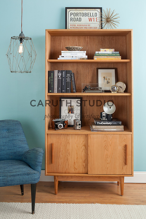 How to Style a Bookcase: Finished case with light on
