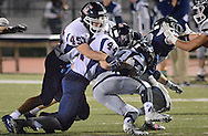 Central Bucks East's Brian Stella (45) and Mike Glauber (44) stop Council Rock North's Michael Welde (28) as he runs with the ball in the first quarter at Council Rock North Saturday October 15, 2016 in Newtown, Pennsylvania.  (Photo by William Thomas Cain)