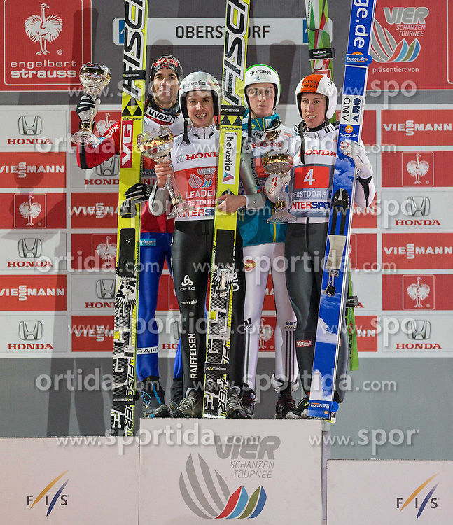 Vierschanzentournee, Podium, im Bild vl. nr. zweiter Platz Anders Bardal (NOR), Sieger Simon Ammann (SUI), dritter Platz Peter Prevc (SLO) und Thomas Diethart (AUT) // from left to right second Placed Anders Bardal of Norway, Winner Simon Ammann of Switzerland , third Place Peter Prevc of Slovenia and Thomas Diethard of Austria celebrate on Podium of 62th Four Hills Tournament of FIS Ski Jumping World Cup at the Schattenbergschanze, Oberstdorf, Germany on 2013/12/29. EXPA Pictures © 2013, PhotoCredit: EXPA/ Peter Rinderer