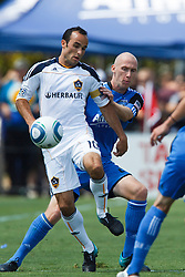 August 21, 2010; Santa Clara, CA, USA;  Los Angeles Galaxy forward Landon Donovan (10) is defended by San Jose Earthquakes defender Tim Ward (20) during the first half at Buck Shaw Stadium.