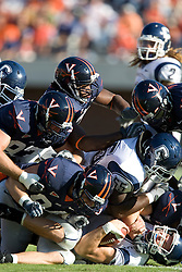 Connecticut quarterback Tyler Lorenzen(4) is sacked by Virginia NT Allen Billyk (94).  The Virginia Cavaliers defeated the Connecticut Huskies 17-16 at Scott Stadium in Charlottesville, VA on October 13, 2007