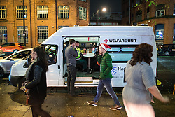 "© Licensed to London News Pictures . 17/12/2016 . Manchester , UK . A Welfare Unit vehicle , with medical facilities , parked on Deansgate Locks . Revellers out in Manchester City Centre overnight during "" Mad Friday "" , named for being one of the busiest nights of the year for the emergency services in the UK . Photo credit : Joel Goodman/LNP"