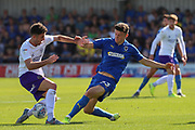 AFC Wimbledon midfielder Callum Reilly (33) nutmegs opponent during the EFL Sky Bet League 1 match between AFC Wimbledon and Shrewsbury Town at the Cherry Red Records Stadium, Kingston, England on 14 September 2019.