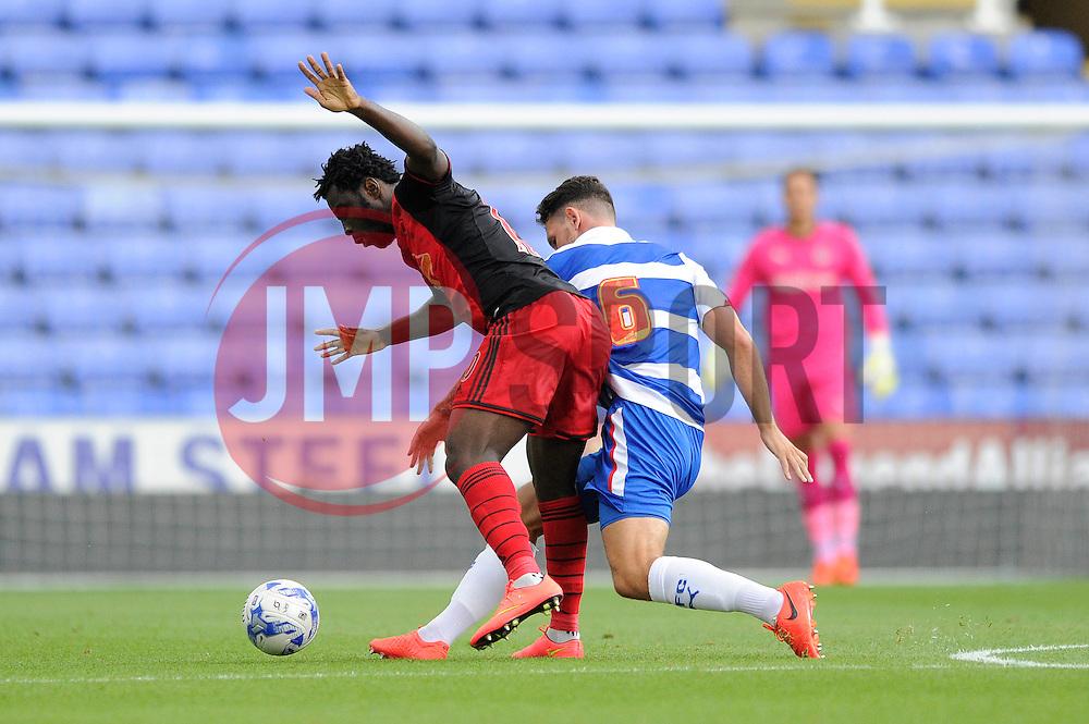 Swansea City's Wilfried Bony is challenged by Reading's Sean Morrison - Photo mandatory by-line: Dougie Allward/JMP - Mobile: 07966 386802 02/08/2014 - SPORT - FOOTBALL - Reading - Madejski Stadium - Reading v Swansea - Pre-Season Friendly