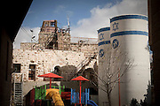 Military posts around new settlements is normal. This one is seen to overlook a playground in Kiryat Arba. Image © Angelos Giotopoulos/Falcon Photo Agency