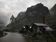 Mountainous landscape with few houses along a road. Cao bang province, vietnam, Asia.