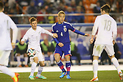 Keisuke Honda (JPN), Michael McGlinchey (NZL) looks on. <br /> MARCH 5, 2014 - Football /Soccer : <br /> Kirin Challenge Cup 2014<br /> between Japan 4-2 New Zealand <br /> at National Stadium, Tokyo, Japan. <br /> (Photo by YUTAKA/AFLO SPORT)