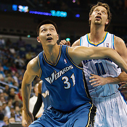 February 1, 2011; New Orleans, LA, USA; Washington Wizards power forward Yi Jianlian (31) posts up against New Orleans Hornets center David Andersen (11) during the second quarter at the New Orleans Arena.   Mandatory Credit: Derick E. Hingle