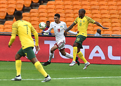 South Africa: Johannesburg: Bafana Bafana player Sandile Hlanti battle for the ball with Seychelles player Karl Hopprich during the Africa Cup Of Nations qualifiers at FNB stadium, Gauteng.<br />