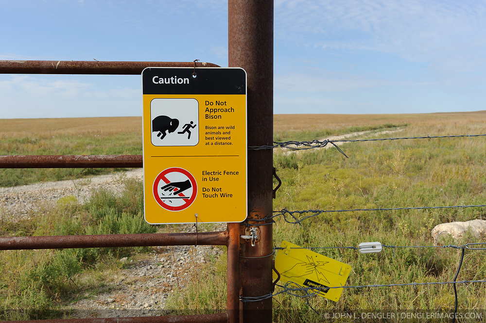 A warning sign at the cattle guard gate to the Windmill Pasture in the Tallgrass Prairie National Preserve warns visitors not to approach the bison herd and of the solar-powered electric fence that is in use. In October 2009, the Tallgrass Prairie National Preserve brought 13 genetically pure bison from Wind Cave National Park in South Dakota. The preserve plans to add more bison from Wind Cave with a final herd size between 75 and 100 bison. The electric fence is powered by a Kyocera Photovoltaic Module (Model KC5COT) solar panel that is connected to a fence battery system manufactured by Taylor Fence, Inc. (Cyclops Power on Demand Brute Battery). The 10,894-acre Tallgrass Prairie National Preserve is located in the Flint Hills of Kansas in Chase County near the towns of Strong City and Cottonwood Falls. Less than four percent of the original 140 million acres of tallgrass prairie remains in North America. Most of the remaining tallgrass prairie is in the Flint Hills in Kansas. Tallgrass Prairie National Preserve is the only unit of the National Park Service dedicated to the preservation of the tallgrass prairie ecosystem. The Tallgrass Prairie National Preserve is co-managed with The Nature Conservancy.