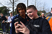 Nathan Ake (5) of AFC Bournemouth signs has a photo with a fan as he arrives at the Vitality Stadium before the Premier League match between Bournemouth and Manchester City at the Vitality Stadium, Bournemouth, England on 2 March 2019.