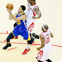 25 May 2015: Golden State Warriors guard Stephen Curry (30) goes for the layup past Houston Rockets forward Terrence Jones (6) during the Houston Rockets 128-115 victory over the Golden State Warriors, in game 4 of the Western Conference finals, at the Toyota Center, Houston, Texas, USA.