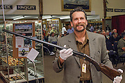 Keith Crowley holding President Theodore Roosevelt's AH Fox shotgun just prior to the sale of the gun at Julia Auction House in Fairfield, Maine.