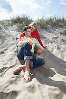 Couple sitting on beach embracing