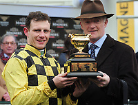 National Hunt Horse Racing - 2019 Cheltenham Festival - Friday, Day Four (Gold Cup Day)<br /> <br /> R Townsend on Al Boum Photo with trainer Willie Mullins and the Gold cup in the 15.30 Magners Cheltenham Gold Cup steeple chase at Cheltenham Racecourse.<br /> <br /> COLORSPORT/ANDREW COWIE