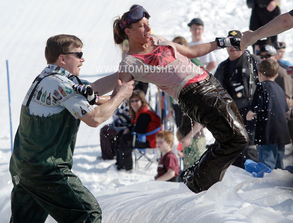 Warwick, New York - A snowboarder is helped out of the water during the annual Spring Rally at Mount Peter Ski and Ride on March 21, 2010.