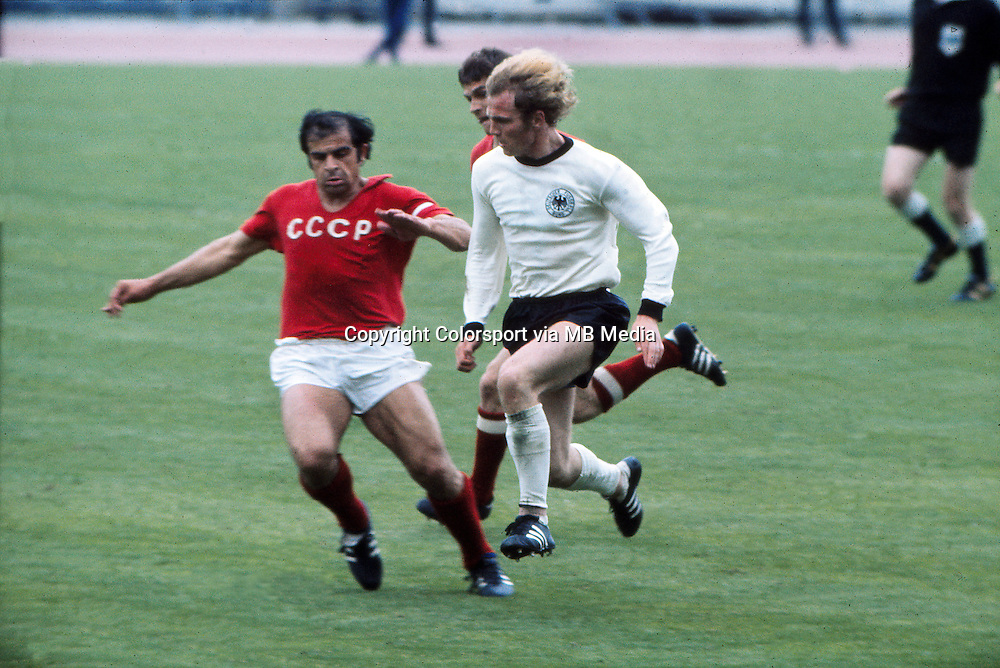 Uli Hoeness (West Germany) Khurtsilava (USSR). West Germany v Russia (USSR). The European Nations Cup Final 1972 18/06/1972. Credit: Colorsport