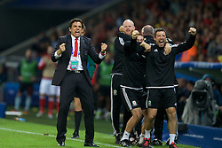 LILLE, FRANCE - Friday, July 1, 2016: Wales manager Chris Coleman celebrates his sides second goal against Belgium during the UEFA Euro 2016 Championship Quarter-Final match at the Stade Pierre Mauroy. Sean Connelly, Ryland Morgans (Pic by Paul Greenwood/Propaganda)