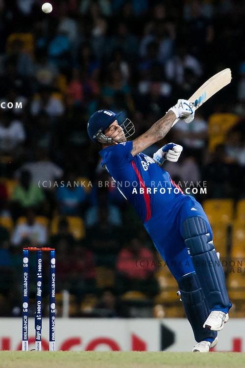 Jade Dernbach loses his balance and tries to play a hook shot one handed during the ICC world Twenty20 Cricket held in Sri Lanka.