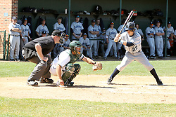 14 April 2013:  Dave Wolak bats, A.J. Nathan catches, Steve Jones umpires during an NCAA division 3 College Conference of Illinois and Wisconsin (CCIW) Baseball game between the Elmhurst Bluejays and the Illinois Wesleyan Titans in Jack Horenberger Stadium, Bloomington IL