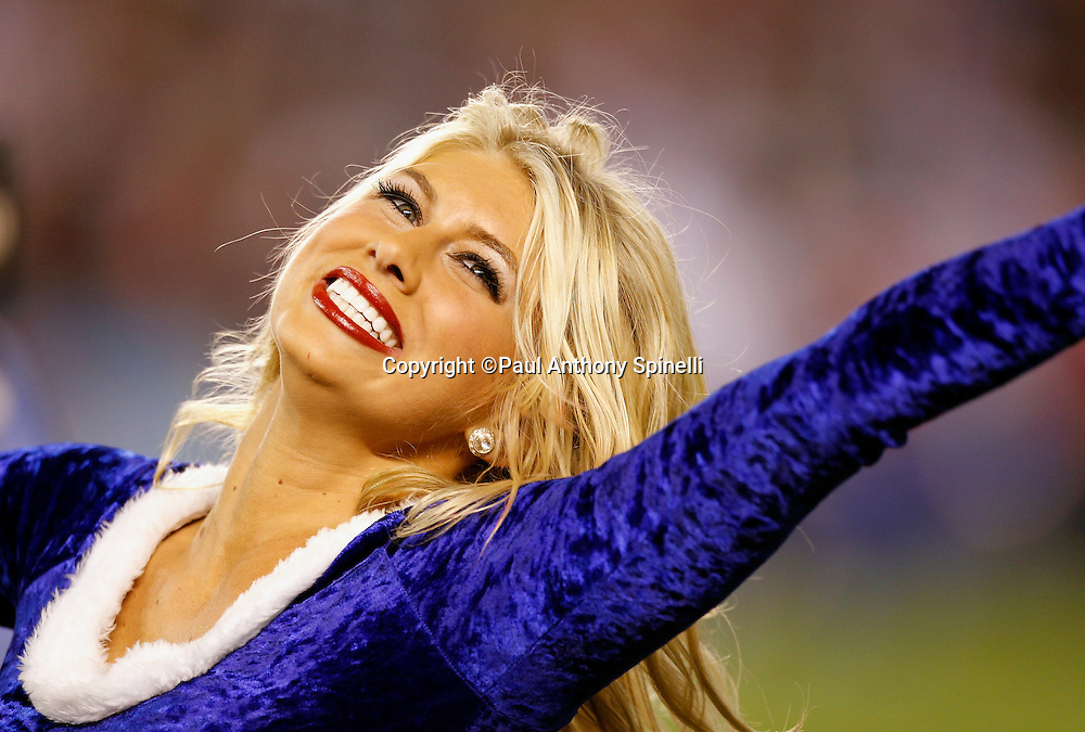 A San Diego Chargers cheerleader smiles and cheers for her team during the NFL week 15 football game against the San Francisco 49ers on Thursday, December 16, 2010 in San Diego, California. The Chargers won the game 34-7. (©Paul Anthony Spinelli)