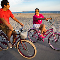 Patricia Gonzalez-Portillo and her son, Alan, ride their bikes and stroll along the beach near their Long Beach, CA home. Model released.