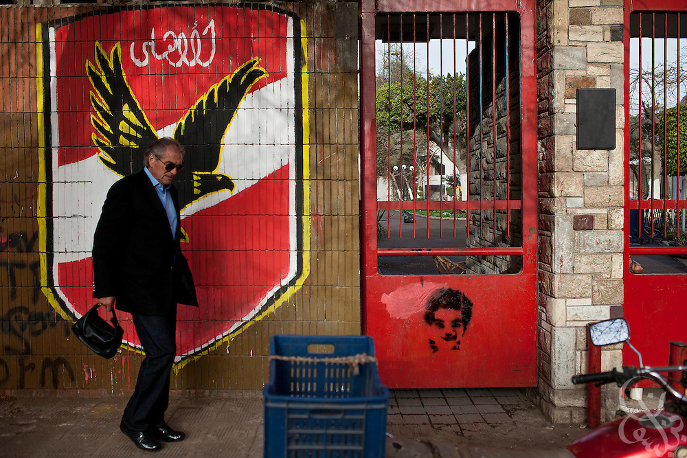 Manuel Jose, the Portuguese Coach of the Egyptian football team Al-Ahly walks past an Al-Ahly mural during his February 17, 2012 return to the Ahly club stadium in Cairo, Egypt. Jose returned to Egypt Feb 16 after a 2 week break to resume his job of coach of Al-Ahly in the wake of post-football match violence February 2nd, 2012 that killed 74 and injured hundreds more in the Port Said, Egypt stadium.  (Photo by Scott Nelson)
