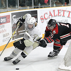 TRENTON, ON - Apr 22, 2016 -  Ontario Junior Hockey League game action between Trenton Golden Hawks and the Georgetown Raiders. Game 5 of the Buckland Cup Championship Series  at the Duncan Memorial Gardens in Trenton, Ontario. Brandon Marinelli #7 of the Trenton Golden Hawks keeps the puck from Daniel Hardie #15 of the Georgetown Raiders during the third period.<br /> (Photo by Tim Bates / OJHL Images)