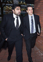 © Licensed to London News Pictures . 05/12/2013 . Stockport , UK . FA referee DEAN MOHAREB (right) arrives at Stockport Magistrates Court this morning (5th December 2013) with solicitor Imran Khan of Lewis-Hymanson Small . Mohareb is charged with perverting the course of justice and unauthorised access to computer data . Photo credit : Joel Goodman/LNP