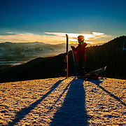 Natalie Segal pulls skins in early morning light on Teton Pass near Jackson, Wyoming.
