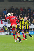 Oldham midfielder Liam Kelly and Burton Albion midfielder Calum Butcher challenge for the ball during the Sky Bet League 1 match between Burton Albion and Oldham Athletic at the Pirelli Stadium, Burton upon Trent, England on 26 March 2016. Photo by Aaron Lupton.